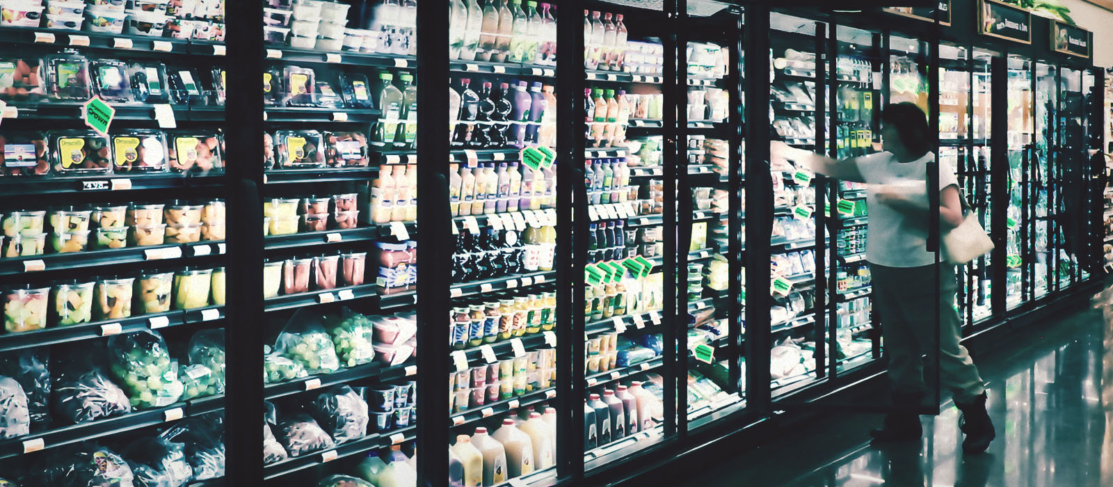 Woman and Refrigerators full of produce
